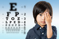 Cute Little Asian Boy Doing Vision Test. Stock Images - 73033514