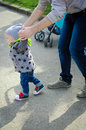 Father Guiding His Baby With The First Steps Royalty Free Stock Images - 73037599