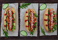 Home Made Hot Dogs With Vegetables, Juicy Sausage And Arugula Stock Image - 73069011
