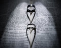Wedding Rings And Heart Shaped Shadow Over Bible Stock Photos - 73079173