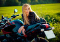 Sexy Fashion Female Biker Girl. Blonde Woman In Leather Jacket Sitting On Vintage Custom Motorcycle. Outdoors Lifestyle Stock Image - 73088781