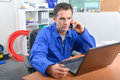 Man On Telephone In Front Computer Royalty Free Stock Image - 73097236