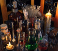 Close Up Of Vintage Bottles, Flask And Candles In Alchemy Laboratory Stock Photos - 73127333