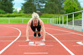 Single Woman Stretching Calf Muscles At Race Track Stock Image - 73130401