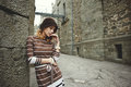 Thoughtful Woman Standing Leaning Against Wall Of Ancient Castle Stock Photos - 73159633