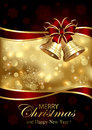 Christmas Bells And Red Bow On Golden Background Royalty Free Stock Photography - 73190047