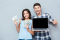 Portrait Of Happy Young Couple Using Laptop Over Gray Background Stock Photo - 73201920