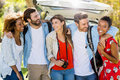 Happy Friends Standing With Arm Around In Park Stock Photography - 73211082