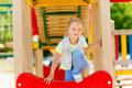 Happy Little Girl Climbing On Children Playground Stock Images - 73223734
