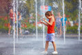 Excited Boy Having Fun Between Water Splashes, In Fountain. Summer In The City Stock Photo - 73263150