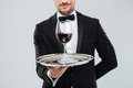 Butler In Tuxedo Holding Silver Tray With Glass Of Wine Stock Image - 73266701