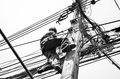 Electricians Repairing Wire At Climbing Work On Electric Post Power Pole Royalty Free Stock Photography - 73313627