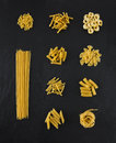 Selection Of Pasta Uncooked, Isolated On Black Slate Background Royalty Free Stock Photo - 73339155