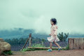 Child Cute Little Girl  Running In The Garden After Rain Stock Images - 73355094