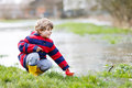 Little Kid Boy Playing With Paper Boat By Puddle Stock Images - 73360214