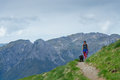 Woman With Her Dog Walking On The Mountain Path Royalty Free Stock Image - 73364836
