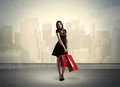 City Woman Standing With Shopping Bags Royalty Free Stock Photo - 73378275