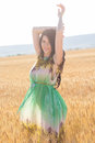 Girl In Rye Field Back View Stock Photography - 73389192