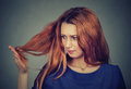 Upset Frustrated Young Woman Surprised She Is Losing Hair, Noticed Split Ends Royalty Free Stock Photo - 73422905