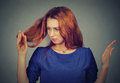 Upset Frustrated Young Woman Surprised She Is Losing Hair, Noticed Split Ends Stock Photos - 73423593