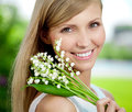 Young Woman With A Beautiful Smile With Healthy Teeth With Flowe Stock Images - 73426364