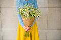 Girl Holding Bouquet Of Camomiles Stock Photos - 73448473