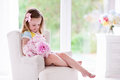 Little Girl With Peony Flowers In White Bedroom Royalty Free Stock Photo - 73464265