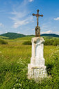 Jesus Christ On Old Wayside Cross In Meadow. Royalty Free Stock Photography - 7352947