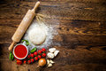 Pizza Dough With Tomato Sauce On Wooden Table Stock Image - 73532531