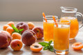 Apricot And Peach Juice With Ice. Royalty Free Stock Images - 73582669