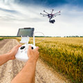 Unmanned Copter. Man Controls Quadrocopter Flight. Stock Images - 73585414