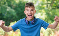Victory Screaming Boy Royalty Free Stock Photo - 73612805