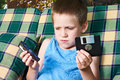 Little Boy With Floppy Disk And Audio Cassette Royalty Free Stock Photos - 73623818