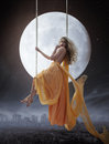Elegant Woman Over Big Moon Background Royalty Free Stock Images - 73627209