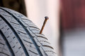 Screw Puncturing Tire Close Up Royalty Free Stock Photography - 73661647