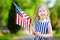 Adorable Little Girl Holding American Flag Outdoors On Beautiful Summer Day Royalty Free Stock Photos - 73662788