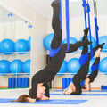 Young Women Doing Aerial Yoga Exercise Or Antigravity Yoga Royalty Free Stock Photo - 73671105