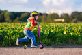 Little Boy Riding A Colorful Scooter Royalty Free Stock Images - 73701509