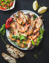Plate Of Roasted Tiger Prawns With Fresh Leek, Lemon, Bread And Salsa Royalty Free Stock Photography - 73707927