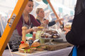 Women Serving Hamburgers On Food Festival In Ljubljana, Slovenia. Royalty Free Stock Photography - 73741997