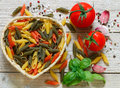 Colorful Italian Raw Pasta. Pasta Penne  Tricolor Royalty Free Stock Images - 73781229