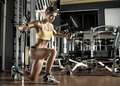 Young Fitness Woman Execute Exercise With Exercise-machine Cable Stock Photography - 73792742
