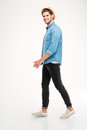 Full Length Of Cheerful Young Man Walking And Smiling Royalty Free Stock Photo - 73795335