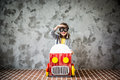Child Driving In A Car Made Of Cardboard Box Royalty Free Stock Image - 73799196