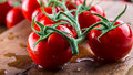 Fresh Cherry Tomatoes Washed Clean Water. Cut Fresh Tomatoes Stock Photography - 73807842