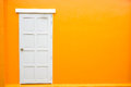 White Door Classic Vintage On The Color Orange Wall Stock Photos - 73829803