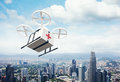 Photo White Generic Design Remote Control Air Drone Flying Sky Medical Box Under Urban Surface.Modern City Background Royalty Free Stock Photography - 73859267