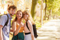 Three Happy Young People Friends Outdoor. Stock Photo - 73881980