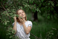 Young Woman Up On A Ladder Picking Apples From An Apple Tree On Royalty Free Stock Photos - 73891108