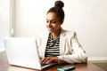 Young African American Business Woman Working On Laptop Royalty Free Stock Photo - 73921225